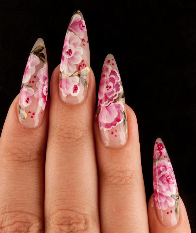 Artificial nails applied by a nail technician.