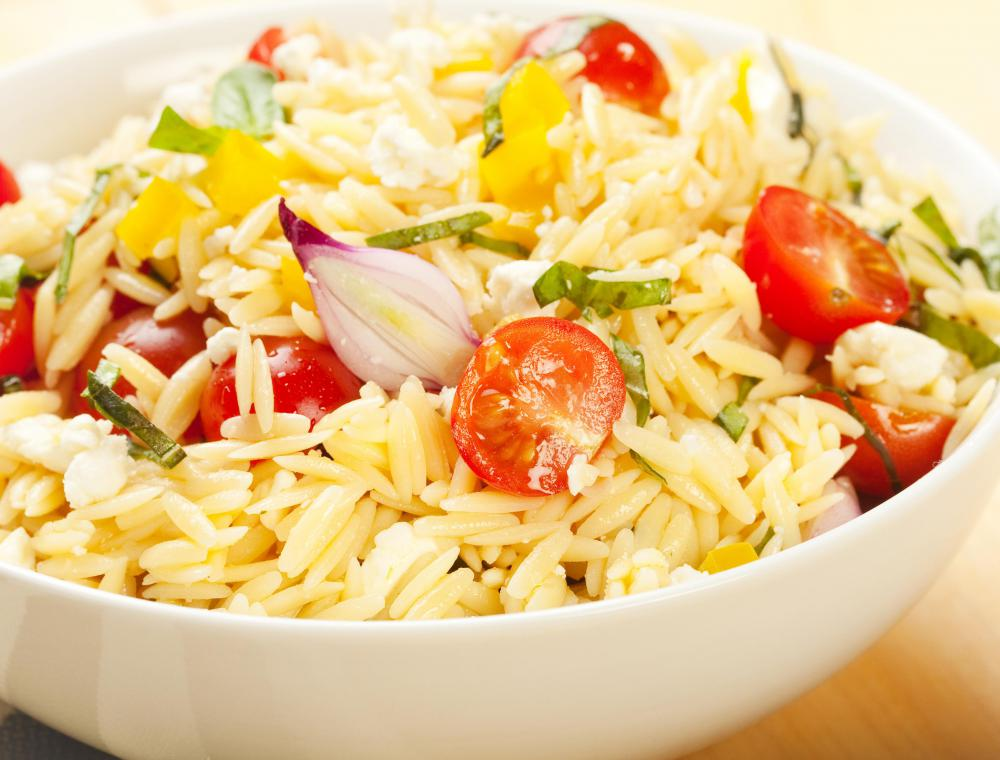 Orzo salad including tomatoes, yellow peppers and onions.