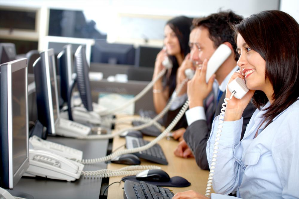 People in a call center helping customers.