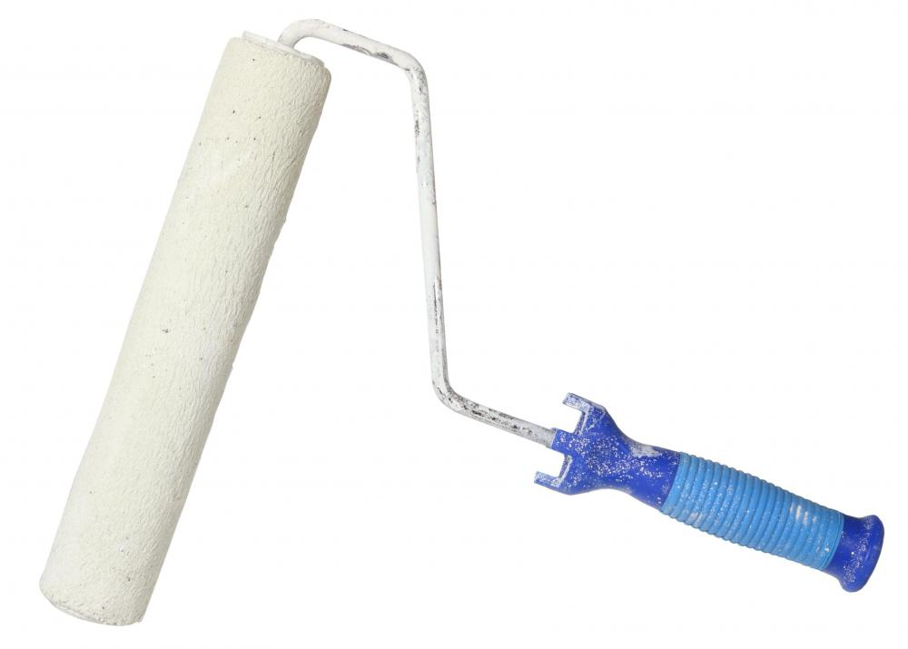 A basic paint roller and pan are essential materials when attempting to stipple a ceiling.