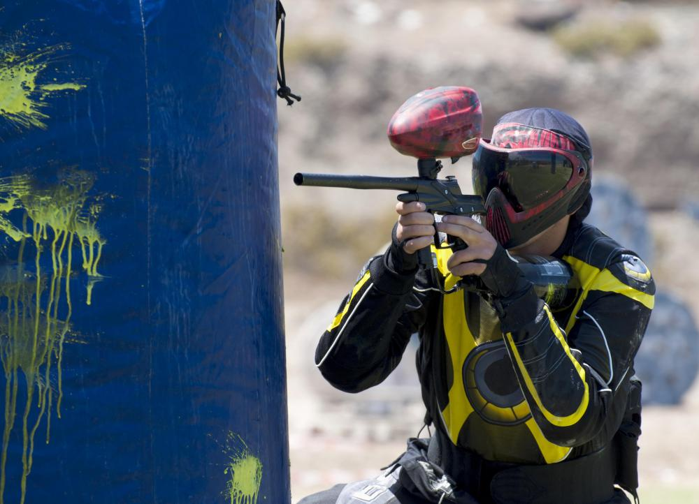 Balls of paint are shot at people during the game of paintball.
