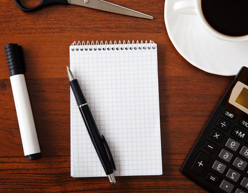 Pens Notebooks And Calculators Are Among The Supplies Every Home Office Should Have