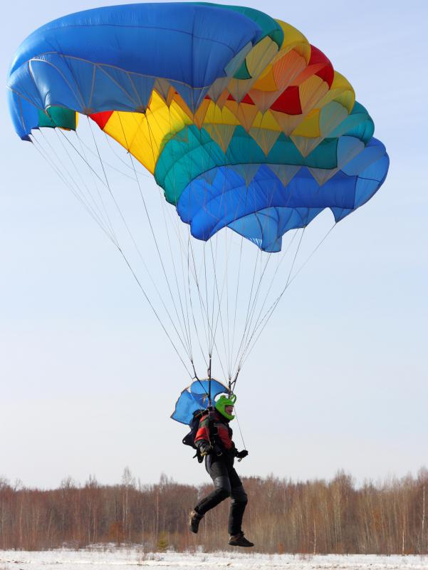 A parachute provides a soft, safe landing for sky divers.
