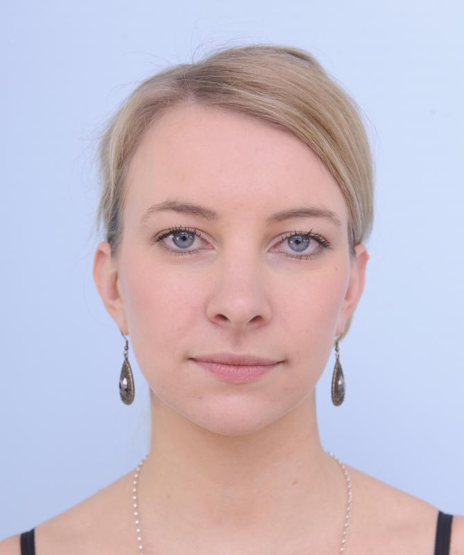 Young Woman With Neutral Expression Headshot Stock Photo, Picture ...