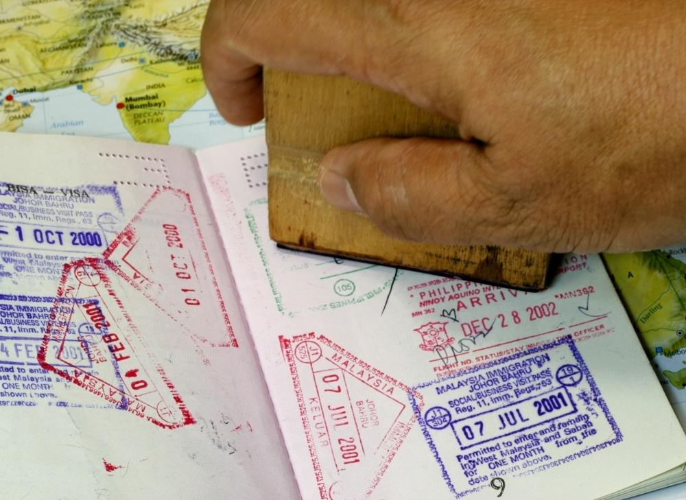 Customs officials stamp the inside pages of a passport when someone enters or exits the country.