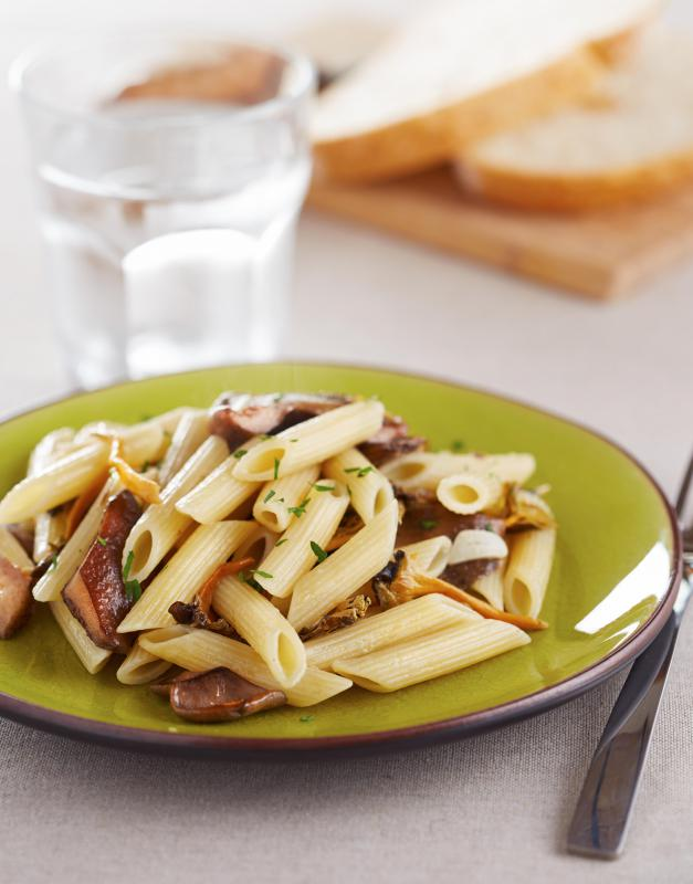 Pasta mixed with mushrooms is a simple and easy vegetarian meal.