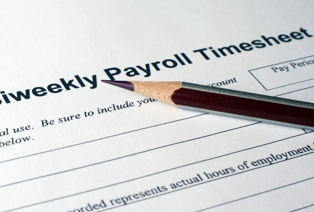 Employee timesheets are used by a payroll processor to issue pay checks.
