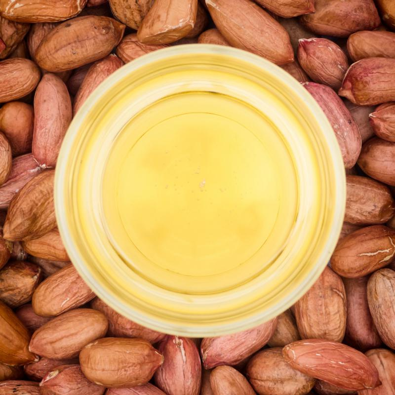 Peanut oil has a high smoking point and mild taste ideal for a salmon stir-fry.