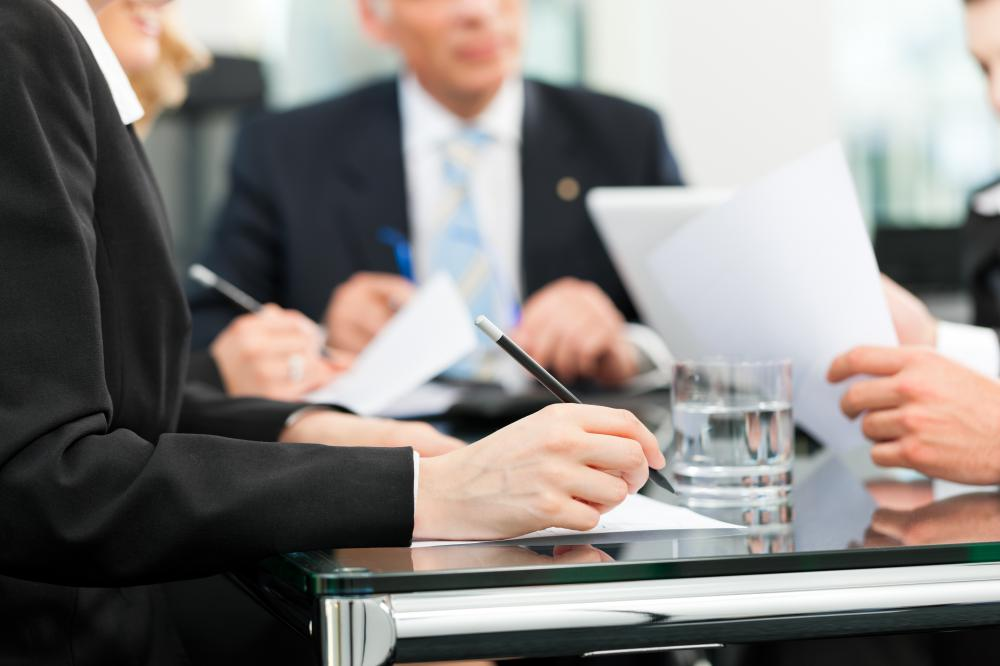 An administrative assistant may have to schedule lunch for those involved in a board meeting.
