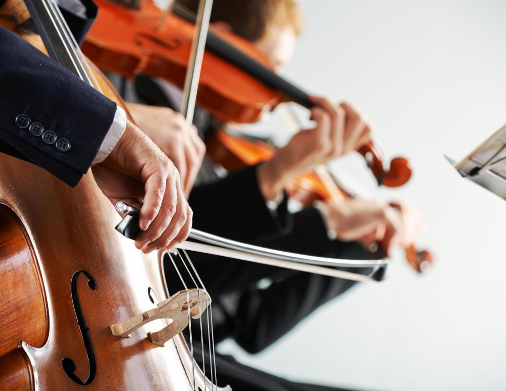 In playing the cello, the hand draws or bounces the bow back and forth across the strings.