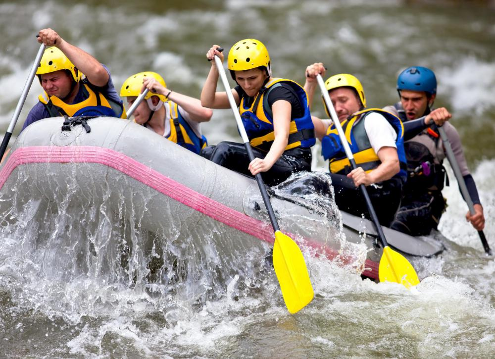 An eco adventure trip might include whitewater rafting.