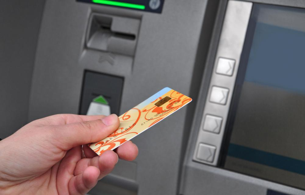 ATMs require a bank card to be inserted before cash can be withdrawn.