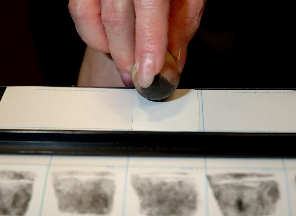 Person having fingerprints taken for an FBI background check.
