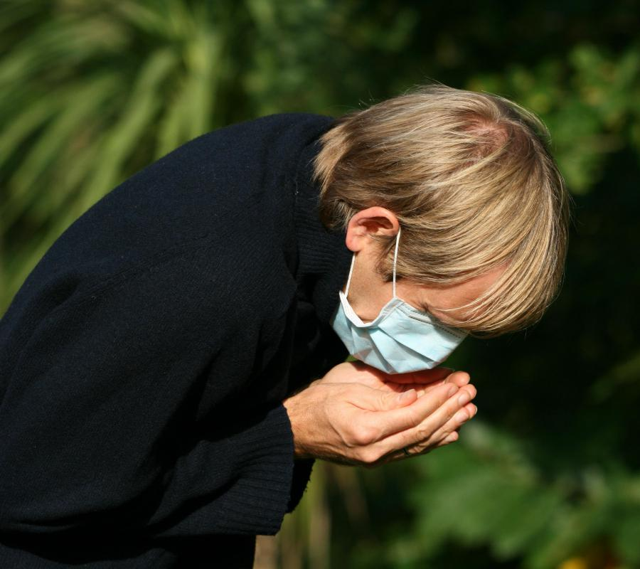 Coughing and wheezing may be symptoms of pneumonia.