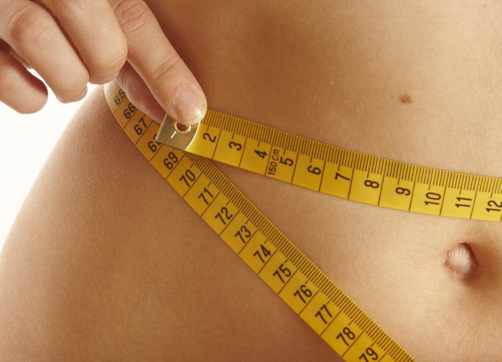 A body wrap can help shrink a woman's waistline and reduce the appearance of cellulite.