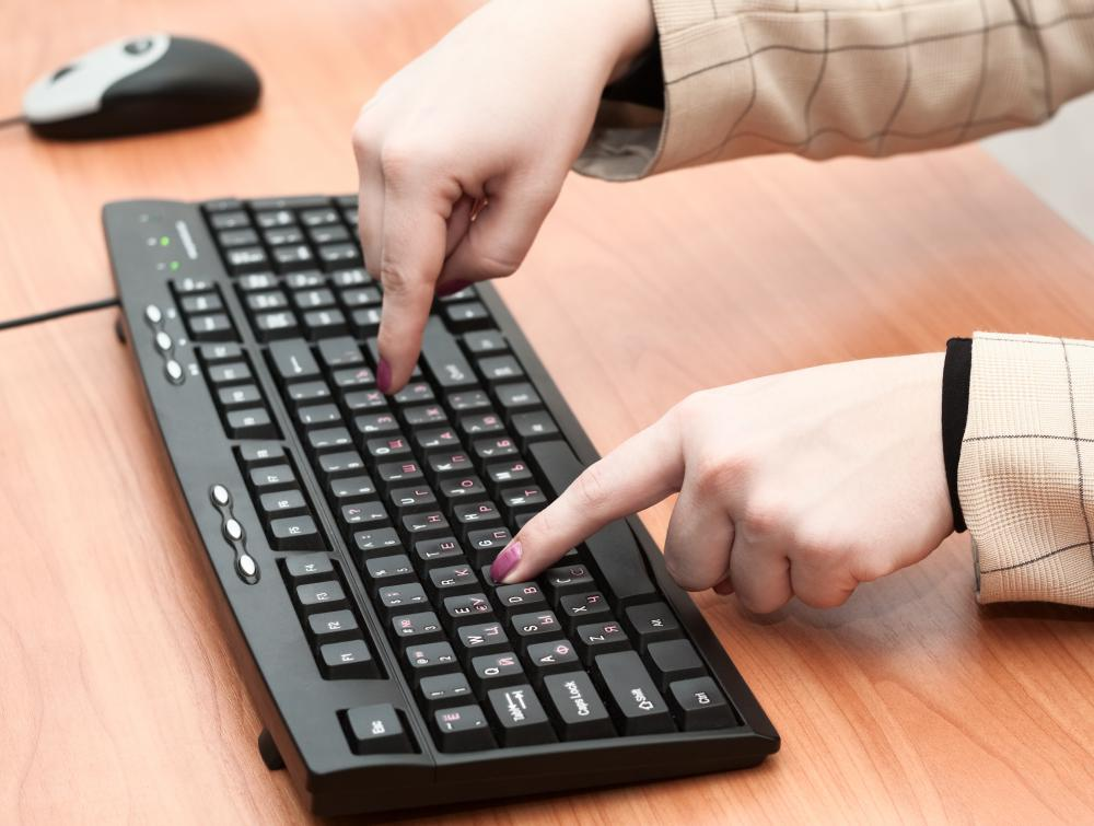http://images.wisegeek.com/person-pecking-on-keyboard.jpg
