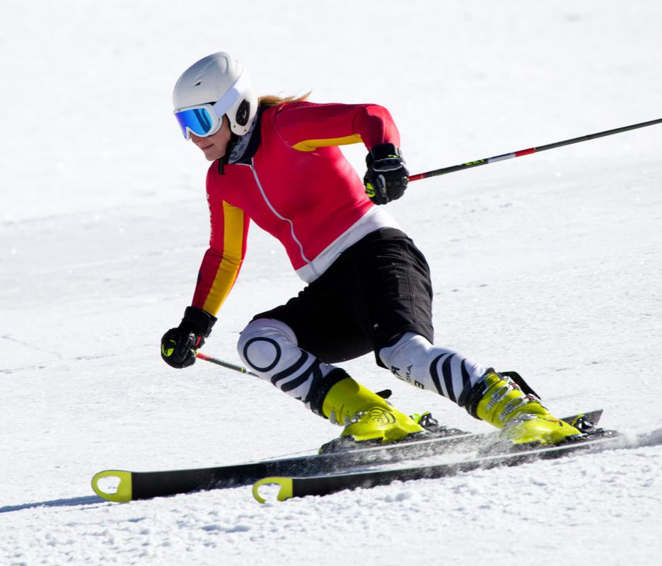 A person skiing before going to a warming hut.