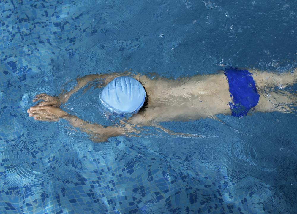 A swimmer's build is not necessarily caused by swimming, nor is is found only among swimmers.
