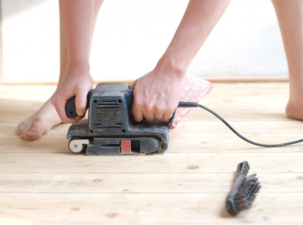 A hardwood floor sander can smooth the floor before painting or refinishing.