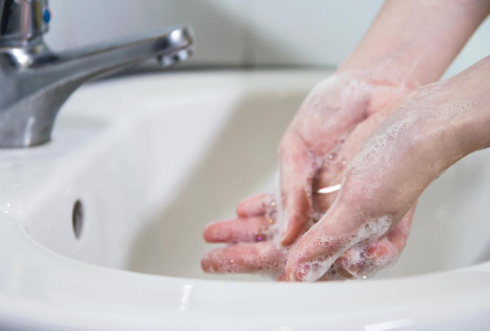 "Scrubbing in"" usually involves thoroughly washing hands with an antibacteria soap."