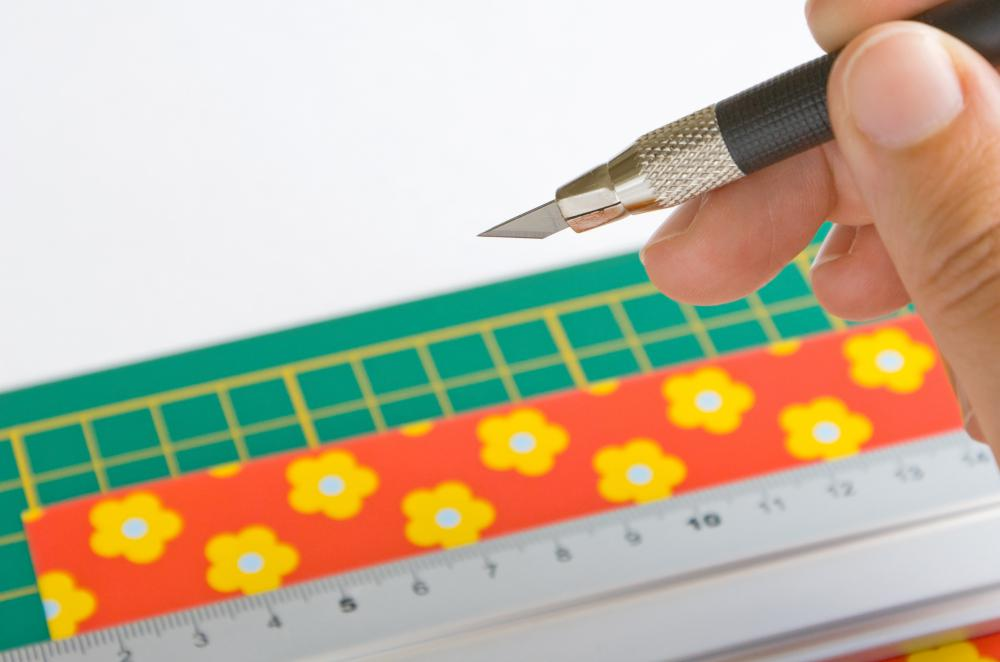 Cutting mats are frequently used to trim a large piece of fabric to the correct size.