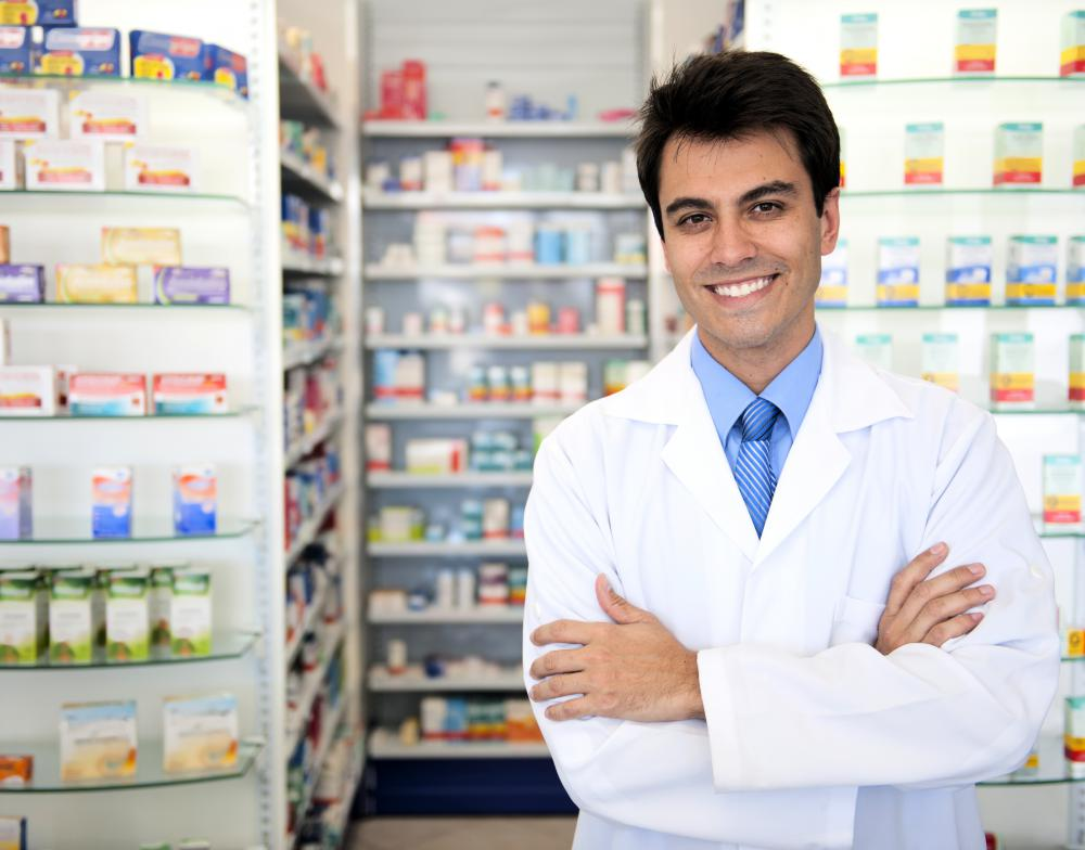 A pharmacist mixes and dispenses medication.