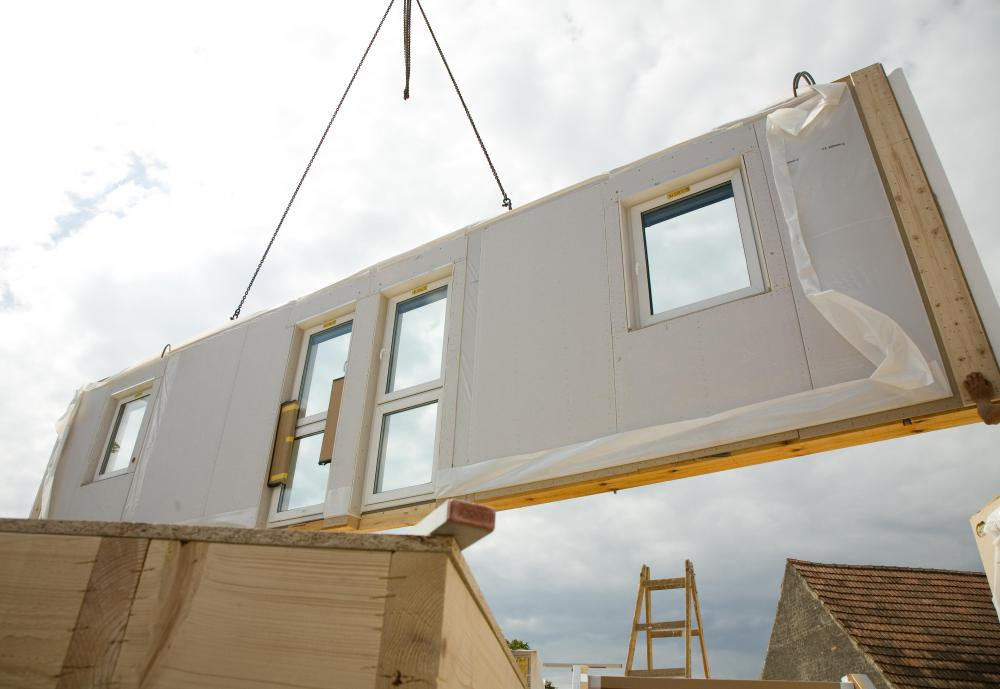 Pieces of a prefab house are shipped to the site where the home will be assembled. & What is a Prefab House? (with pictures)