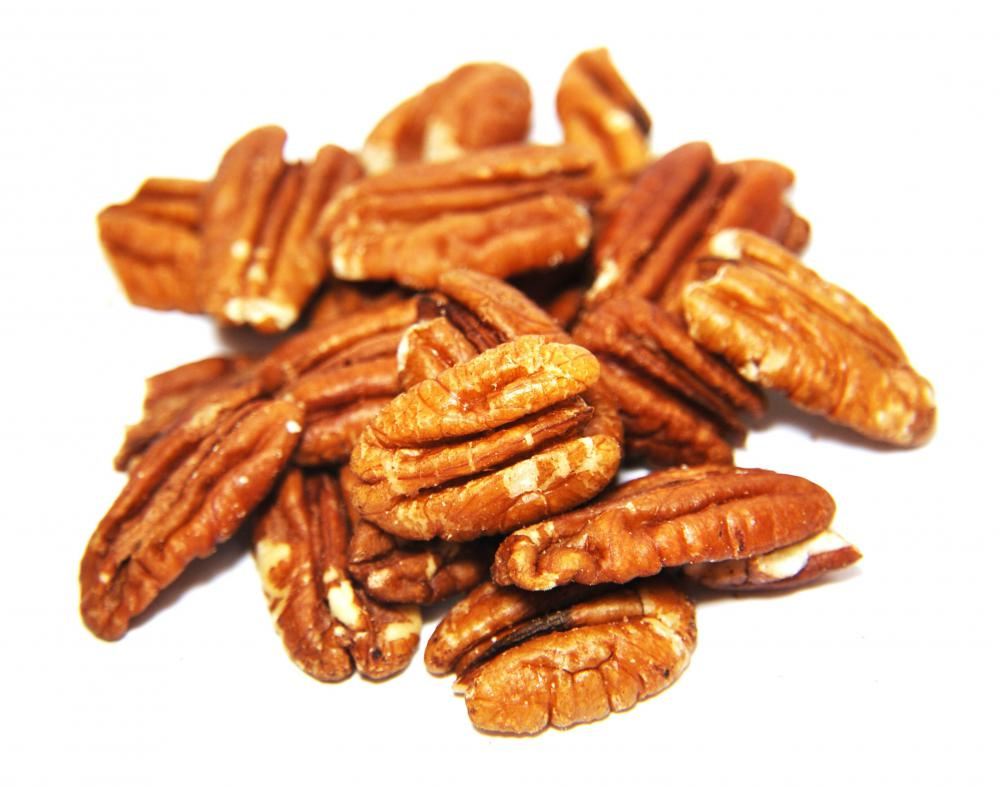 Pecans are sugar coated and baked to make candied pecans.