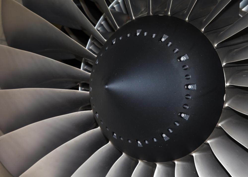 The intake fan on a turbofan jet engine draws air into the engine's compressor stage.