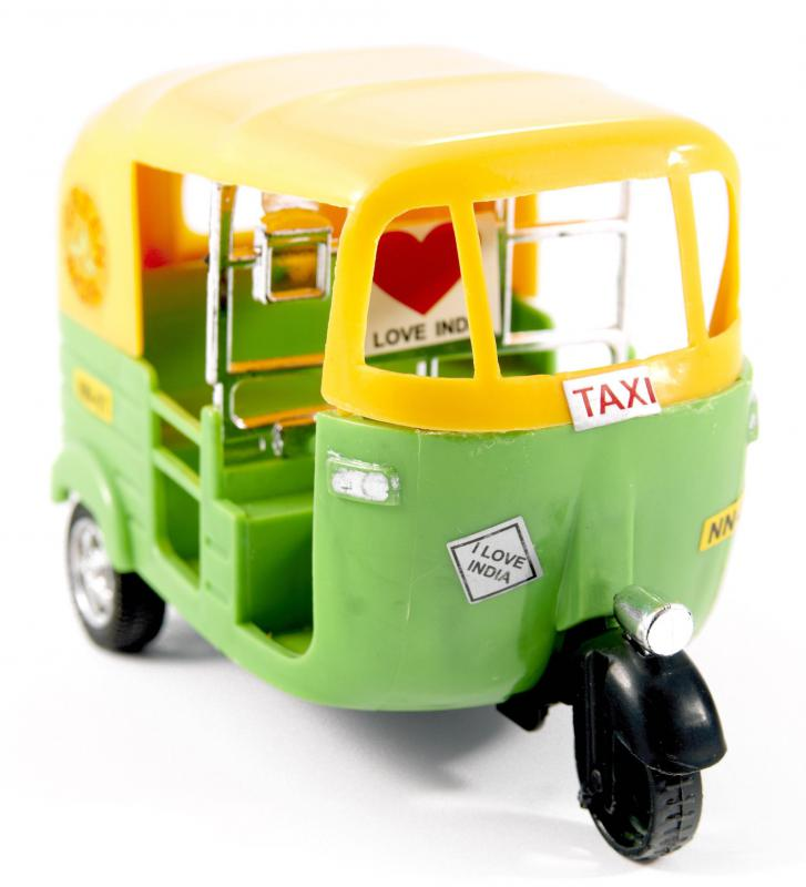 Plastic auto-rickshaw made with multiple injection-molded parts.