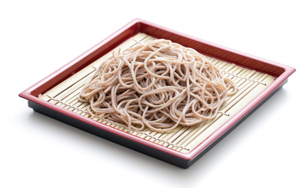 Plate of cooked soba noodles, which are often served with tempura.