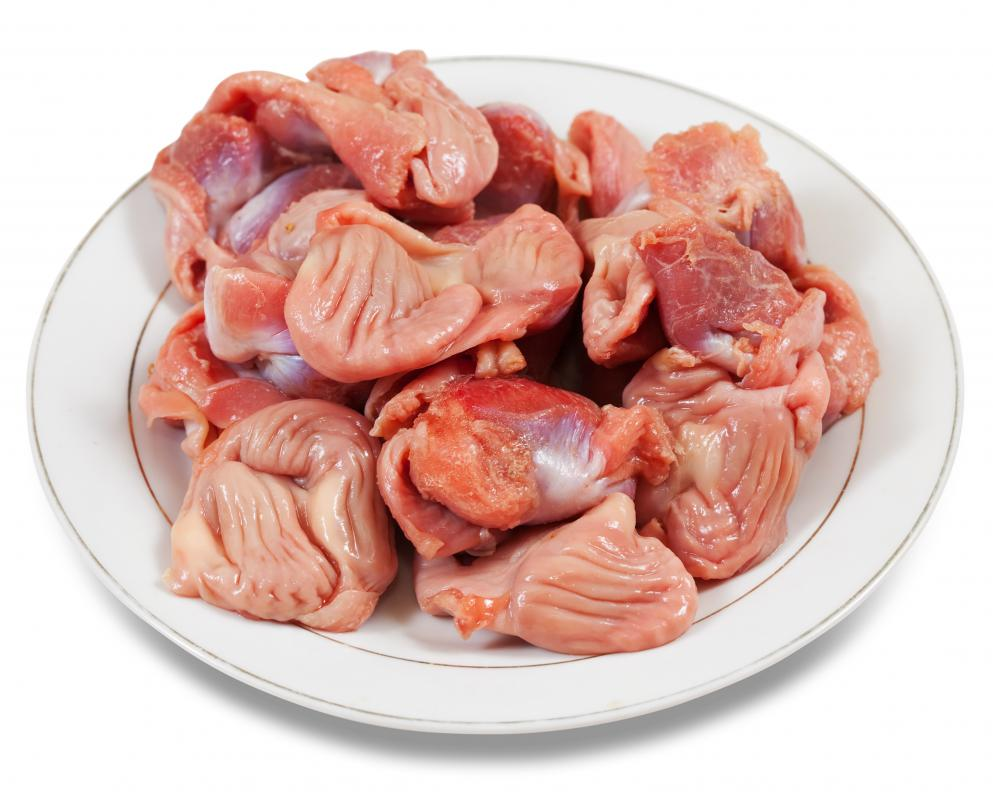 Plate of raw chicken gizzards.