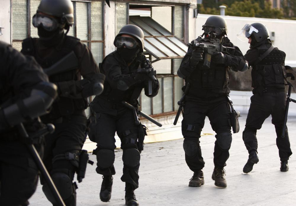 SWAT teams may be called in to deal with riots.