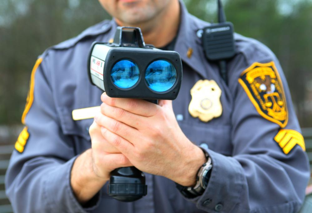 Law enforcement monitors motorists's speeds.