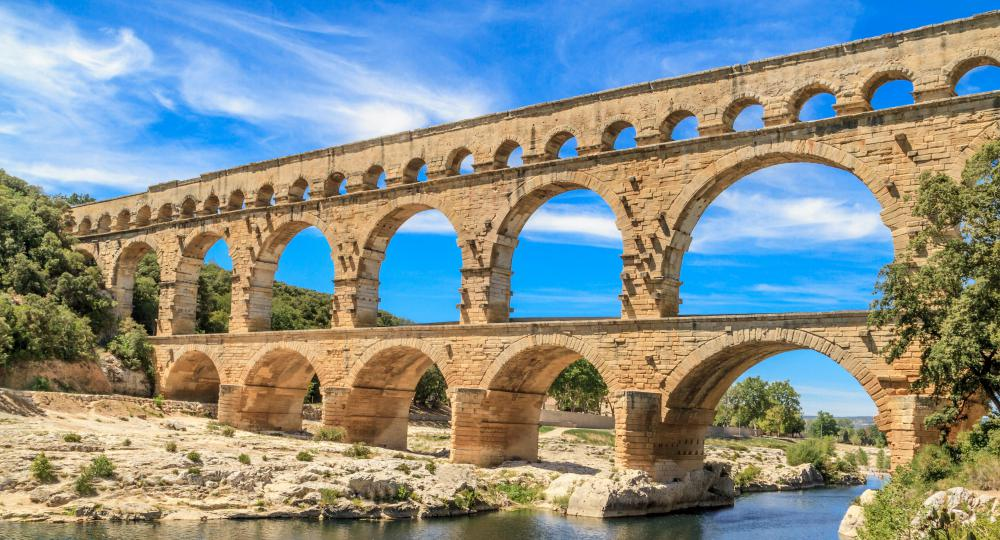Remnants of the extensive aqueduct network that the Romans used to transport water to their major urban centers can still be seen today.