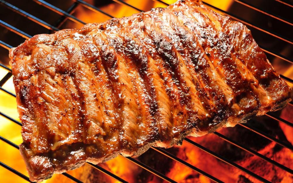 Ribs are usually marinated first, then basted in sauce while they grill.