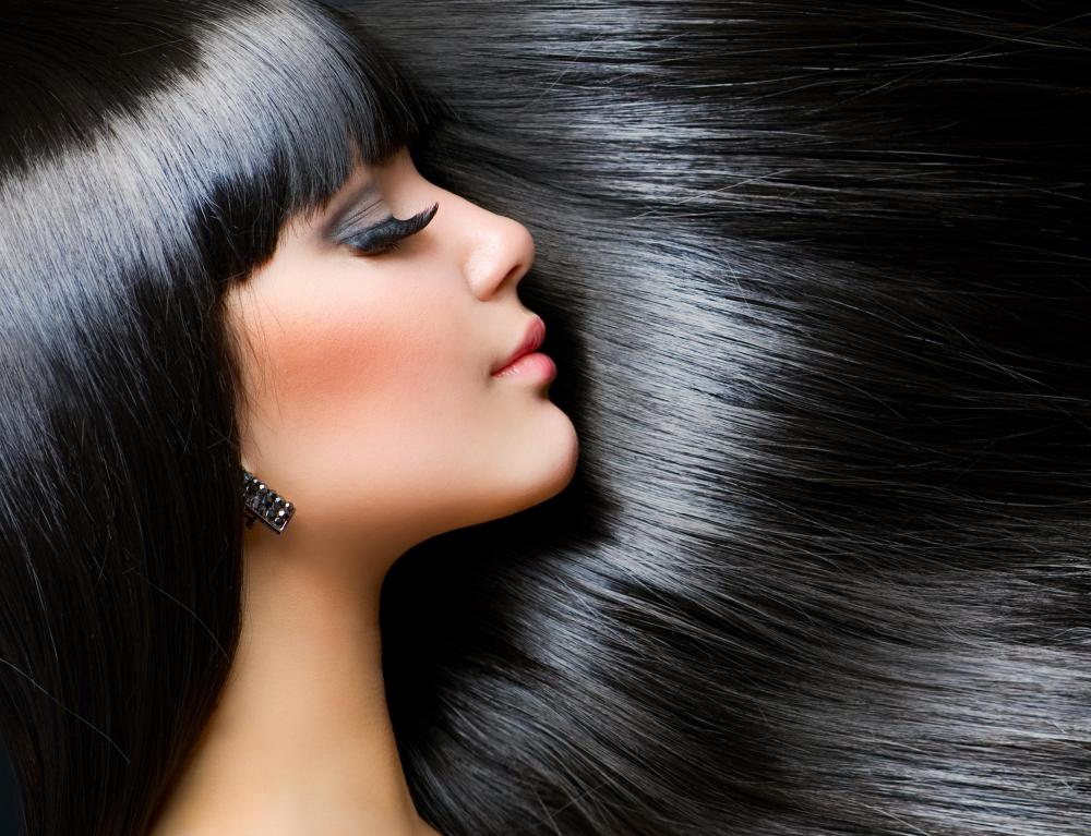Gentle brushing keeps black hair shiny without causing damage to the follicles.