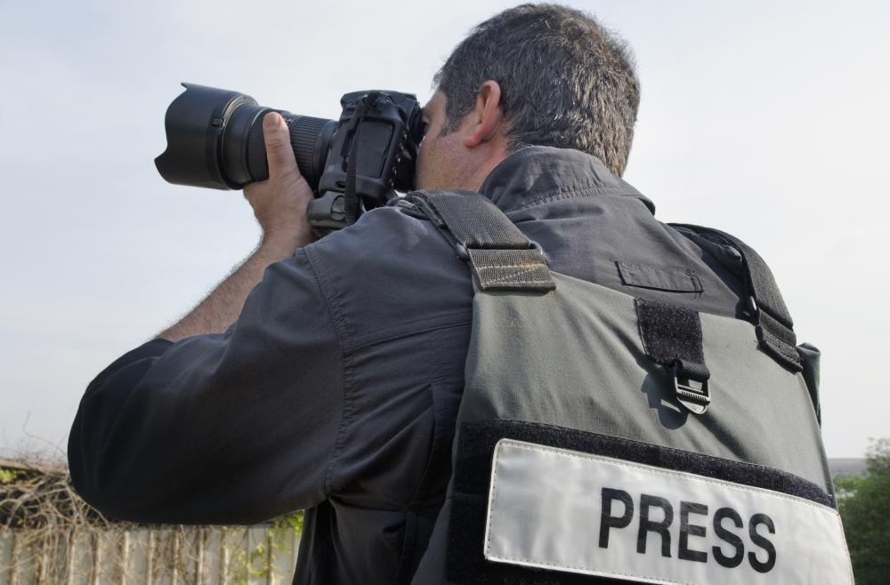 A press photographer, working either for a media outlet or on a freelance basis, provides images that convey a story.