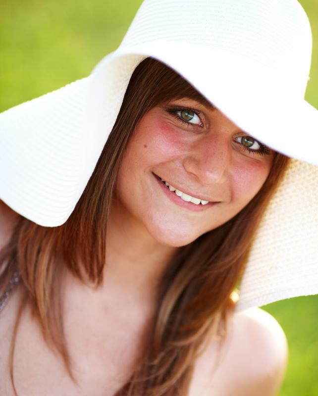 Wearing a hat while out in the sun can protect your hair from becoming dry.