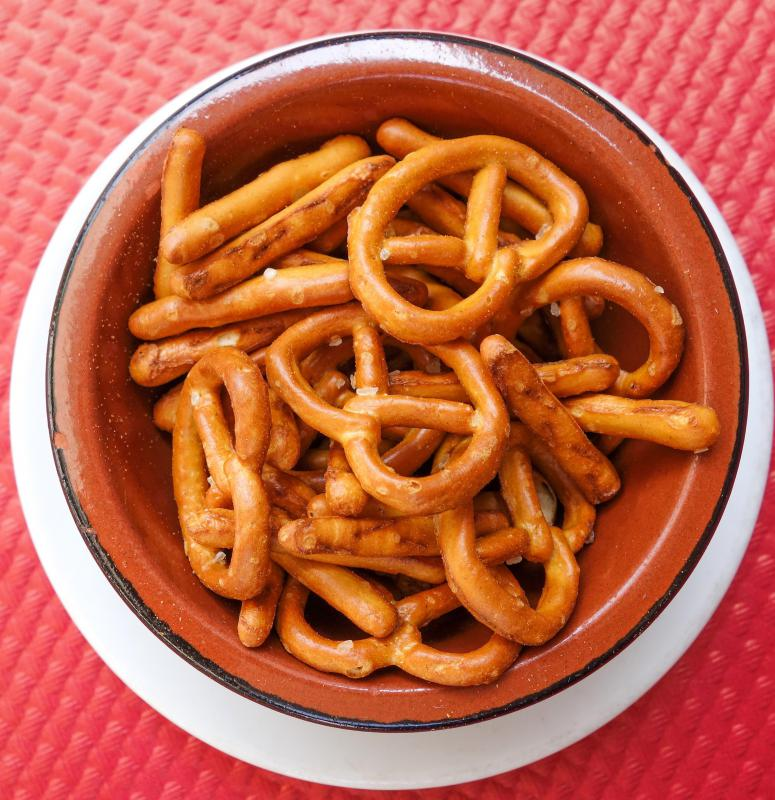 Snacks, like pretzels, can be set out on tables for guests to nosh on during the Super Bowl.