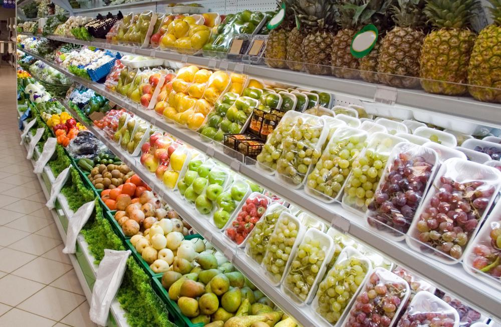 Various types of fruit in a grocery store.