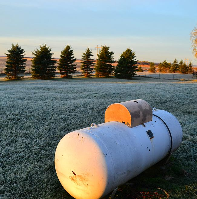 A propane tank can hold fuel to heat water pipes.