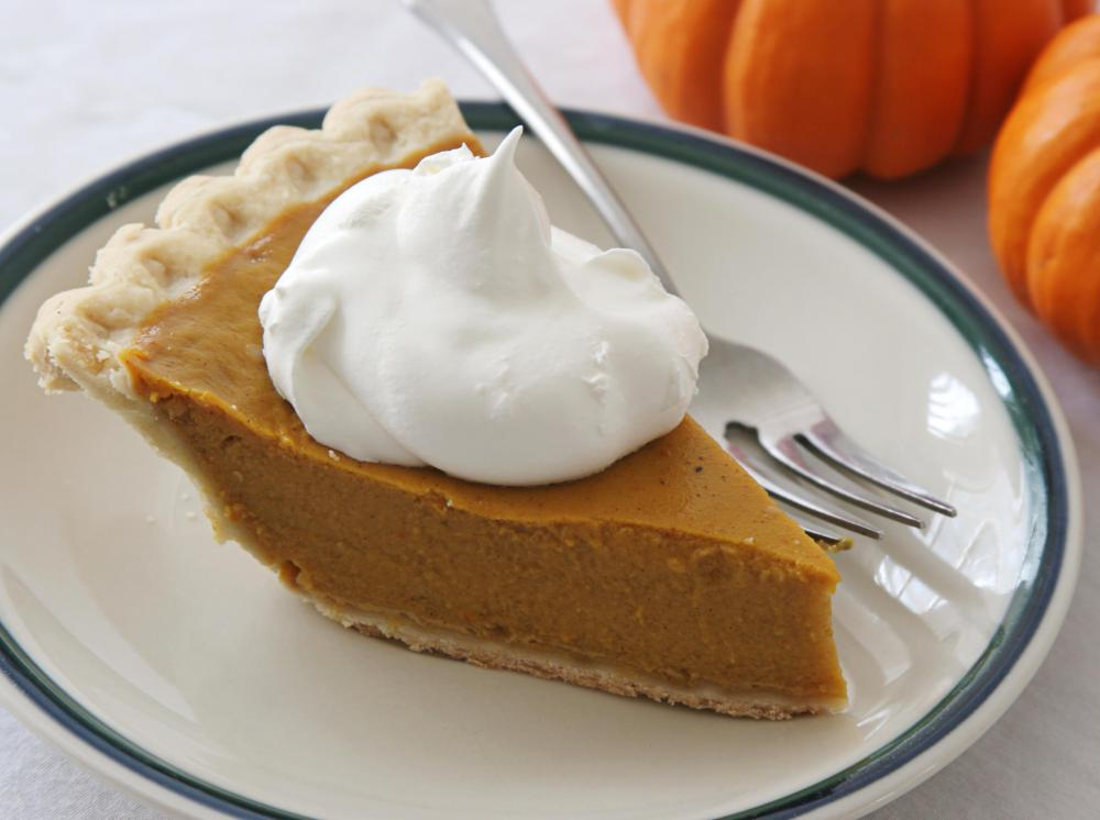 Pumpkin-related foods, including pies, are available at a pumpkin festival.