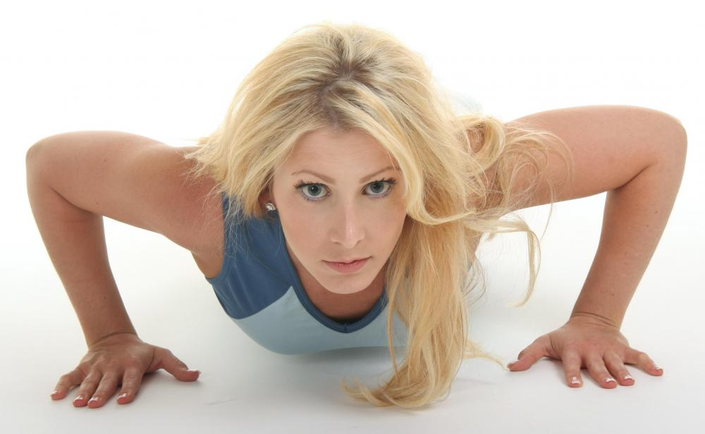 In a proper push up pose, a person's hands are about one hand-width away from her sides.