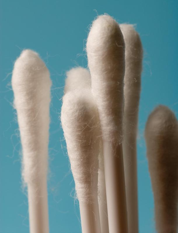 Cotton swabs may be used to clean toothpaste off of sinks and mirrors.