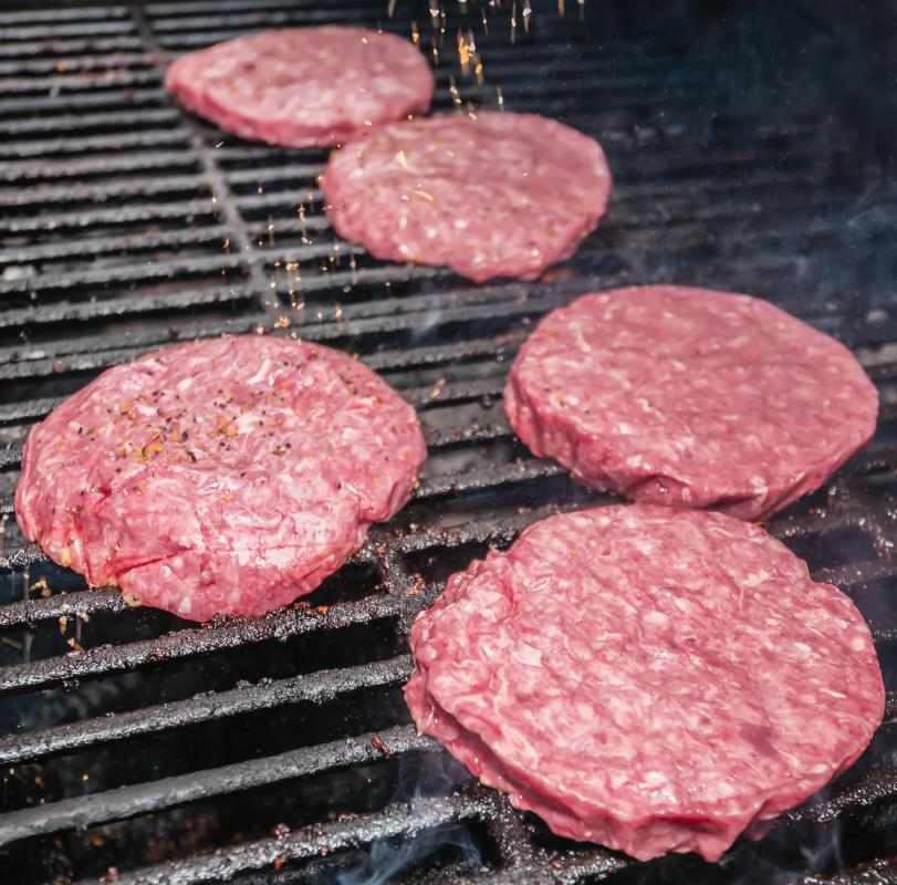Mini hamburgers might be grilled and served at a picnic.