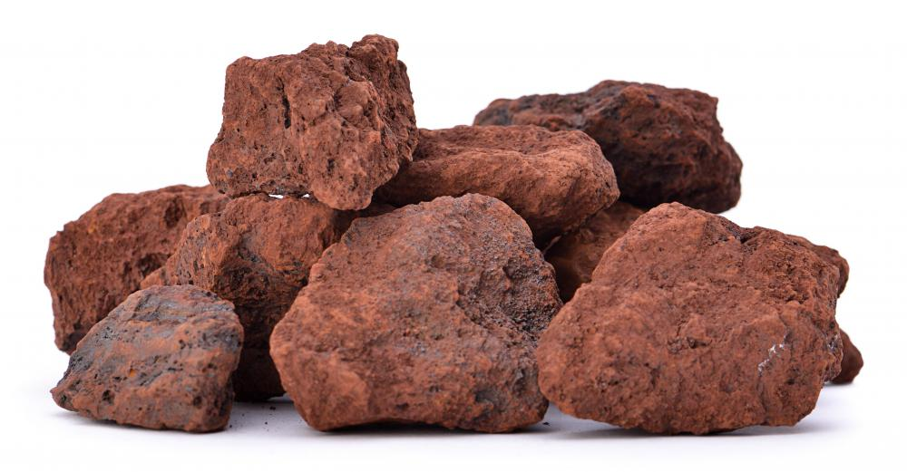 Iron ore is combined with charcoal in a blast furnace to create pig iron.