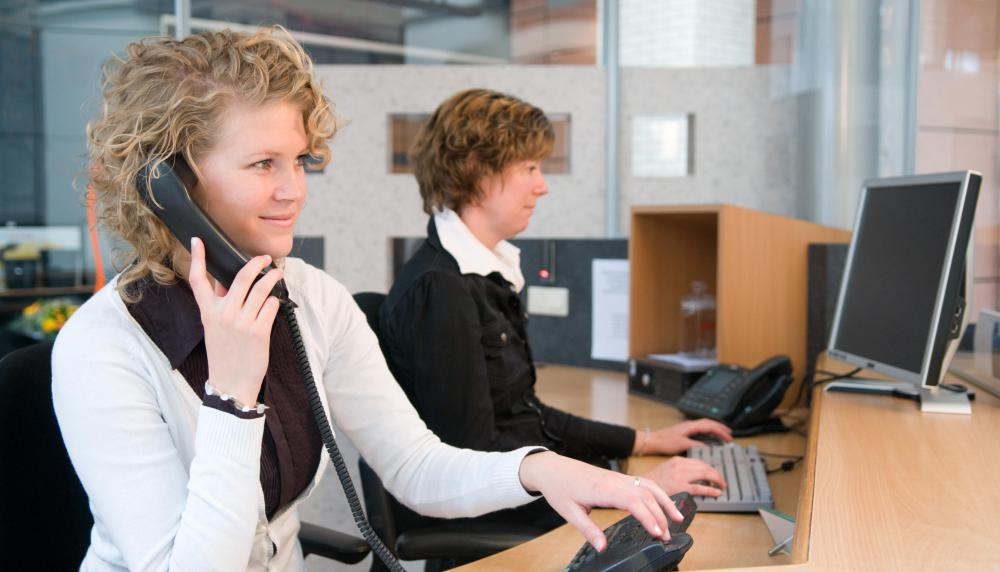 Answering phones is a common part of secretary work.