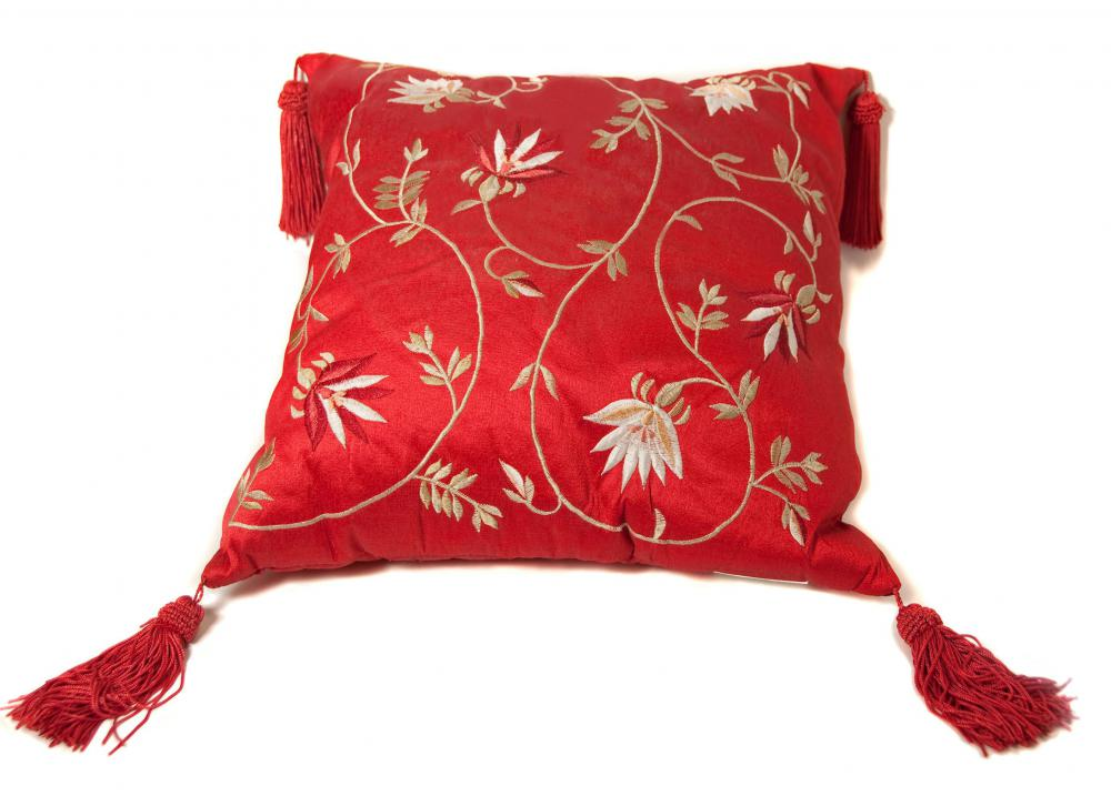 A pillow with an embroidered pillow case.