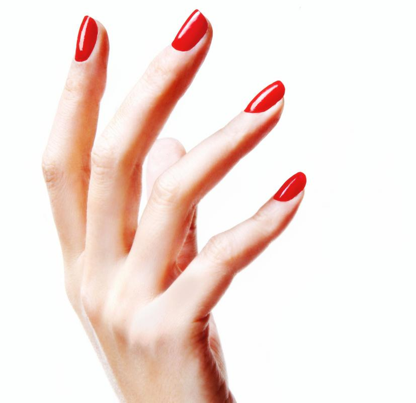 A woman with gel nails applied by a mobile nail technician.